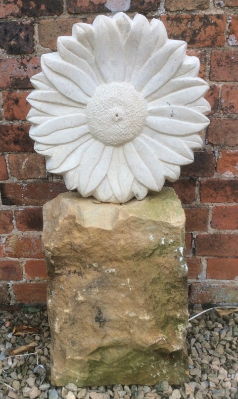 Sculpture of a flower carved in Bath stone