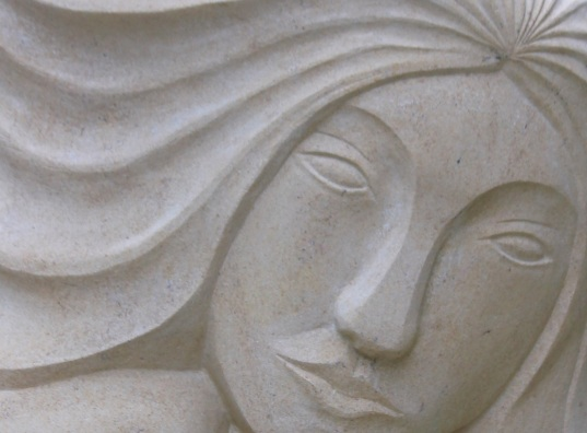 Carved Portland stone face sculpture