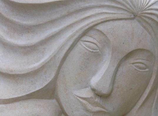 Carved Portland stone face sculpture