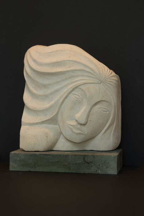 Sculpture of female head: carved in Portland stone