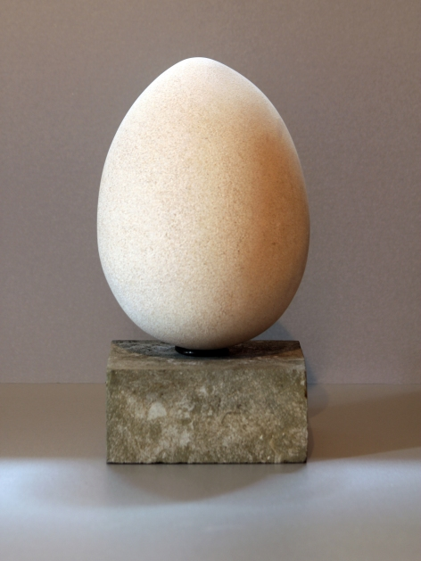 Asymmetry : sculpture of egg carved in Portland stone