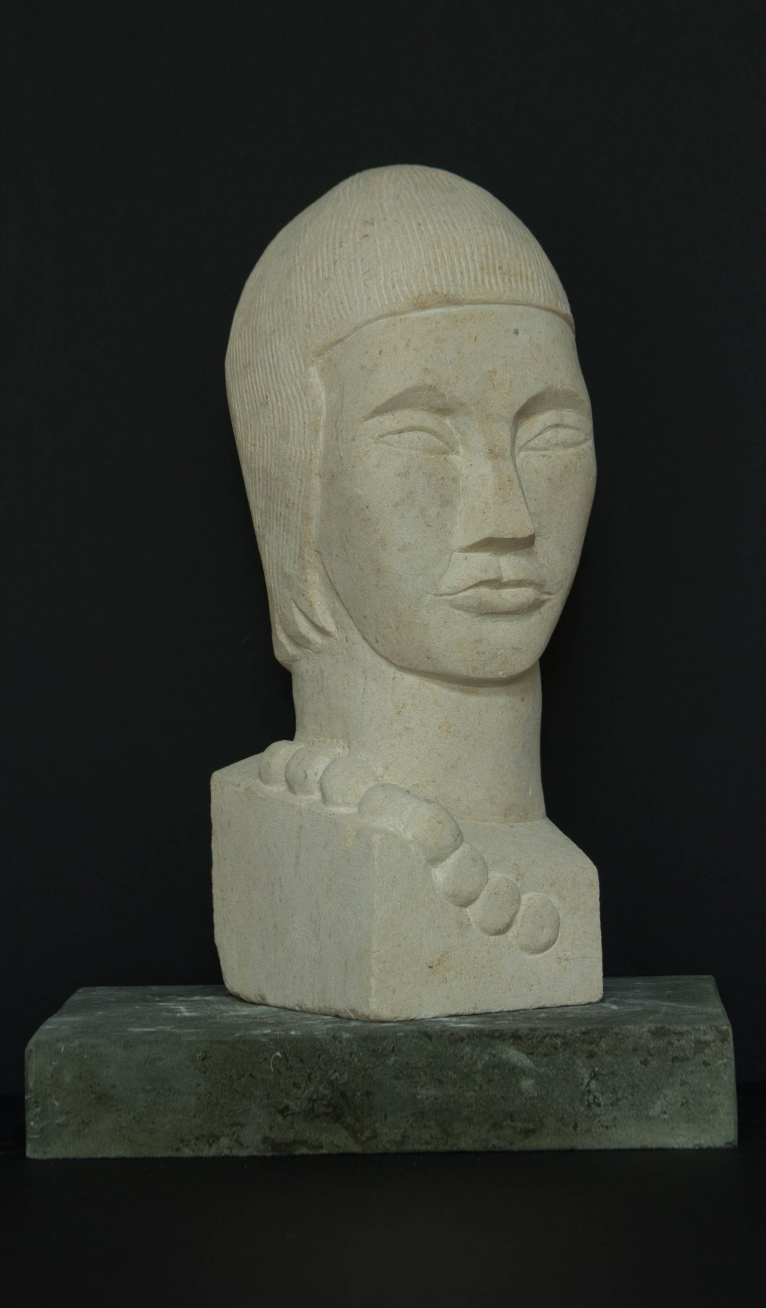 Woman with a necklace head sculpture: carved in Portland limestone