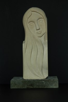 Dreaming face sculpture: carved in Caen limestone