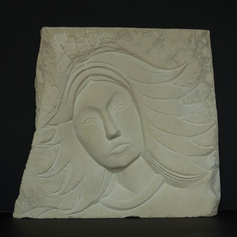 face sculpture of an unknown goddess: carved in Caen limestone