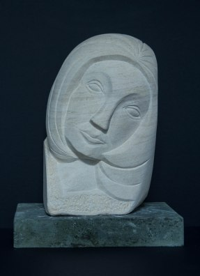 face sculpture: carving in French limestone