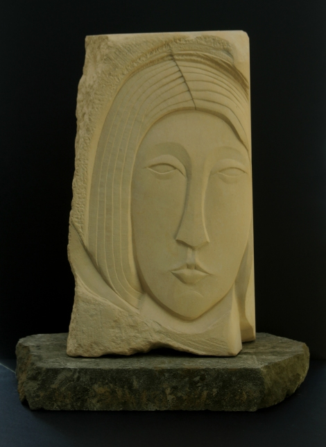 Head carved in Caen Limestone